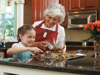 grandmother-granddaughter-making-cookies